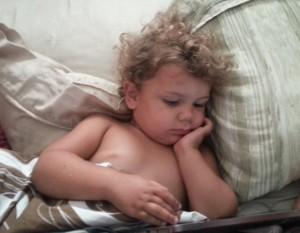 Cydnee watching netflix on the tablet before anyone else woke up