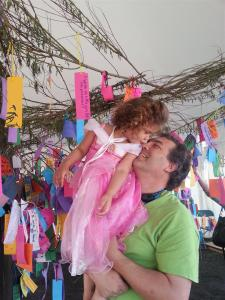 "Cydnee (as Aurora) gives dad a kiss after he helped her hang her Hopes and Dreams on the Dream Tree (hers was ""I wish every little girl felt like a princesss"")"