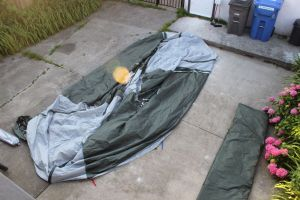 the fly is protected, the tent opens under it for rainy setups, the doors are ready to be used
