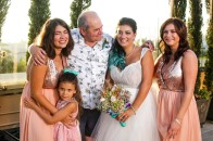 Chantell with her grandfather and sisters and a great bouquet